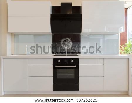 Interior of a modern white and black kitchen - stock photo