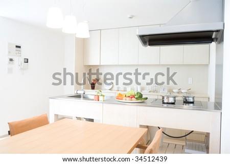Interior of a modern white kitchen - stock photo