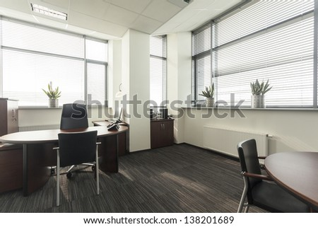 Interior of a new contemporary office, table - stock photo