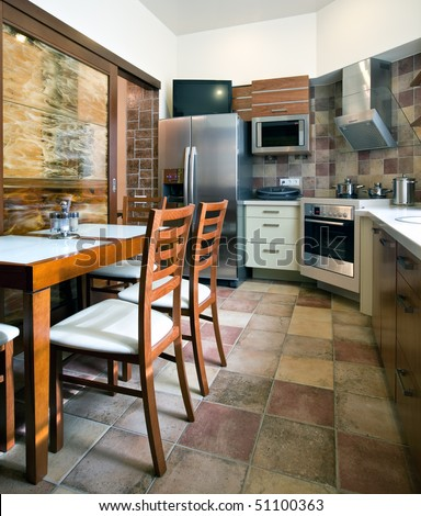 Interior of a new customized kitchen in daylight - stock photo