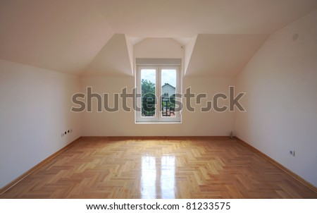 Interior of a new home, empty room with white walls and parquet. - stock photo