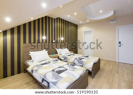 Interior of a new hotel double bed bedroom in the attic