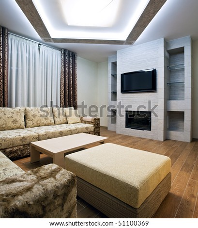 Interior of a new living room with fireplace - stock photo