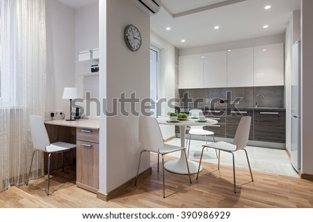 Interior of a new modern apartment in scandinavian style with kitchen and workplace - stock photo