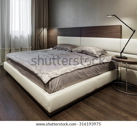Interior of a new modern bedroom - stock photo