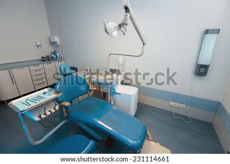 Interior of a new modern dental office, in blue colors - stock photo
