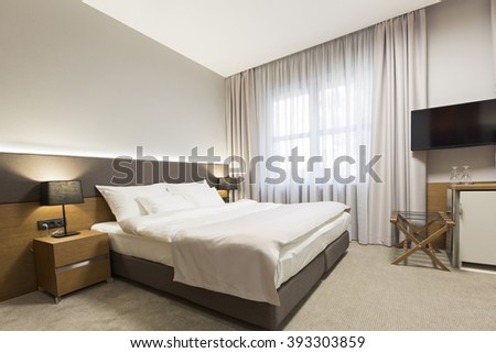 Interior of a new modern hotel bedroom - stock photo