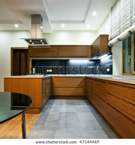 Interior of a new modern wooden kitchen - stock photo