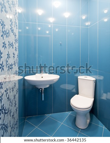 Interior of a new toilet room in blue colors