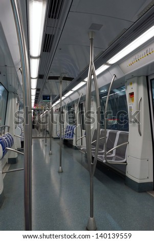 Interior of a passenger metro train with empty seats. Barcelona, Spain.