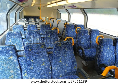 Interior of a passenger train with empty seats - stock photo