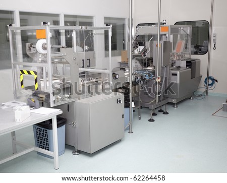 interior of a pharmaceutical industry equipment for packing pills boxes - stock photo