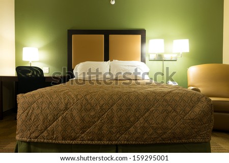 Interior of a queen size bed hotel bedroom - stock photo