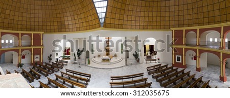 Interior of a religious temple. Empty church. Banks in an empty church. - stock photo