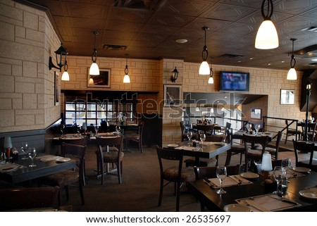 interior of a restaurant bar, wooden table and chair - stock photo