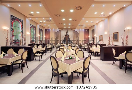 Interior of a restaurant in a hotel, during evening. - stock photo