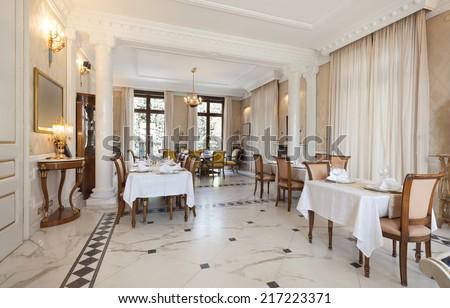 Interior of a restaurant in luxury villa - stock photo