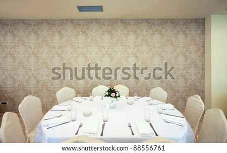 Interior of a restaurant prepared for wedding ceremony. - stock photo