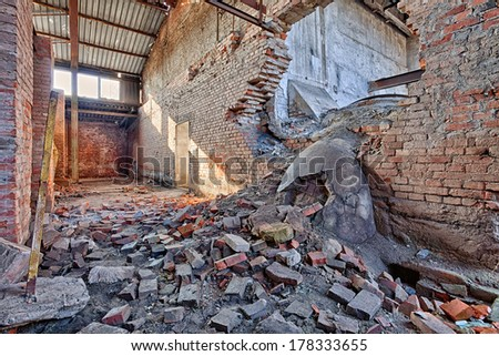 Interior of a ruined brick factory - stock photo
