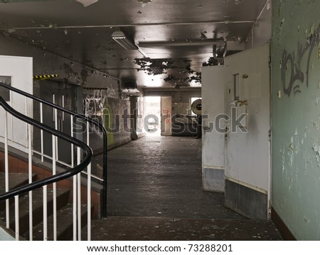Interior of a ruined industrial building - stock photo