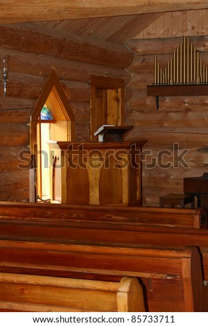 Interior of a small log church in the country - stock photo
