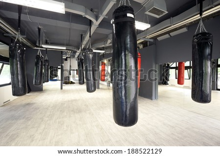 Interior of a spacious gym with punching bags - stock photo