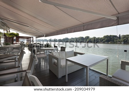 Interior of a summer terrace of a floating restaurant  - stock photo