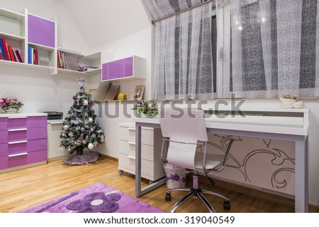 Interior of a teenage girl room with decorated  New Year tree - stock photo