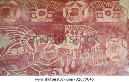 Interior of a temple in Teotihuacan, Mexico, with religious figures painted in a wall.