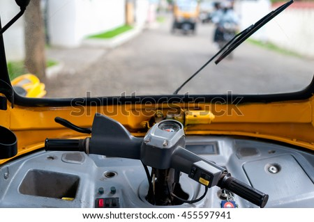 Interior of a Tuc tuc parked on a street in India