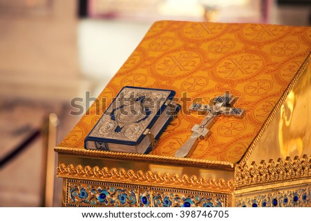Interior of a very small chapel with holy bible, golden cross