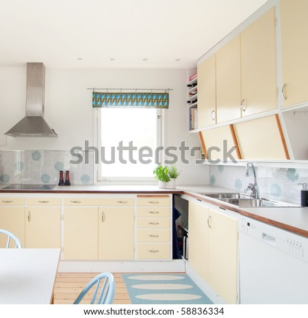 interior of a vintage kitchen in 50s style - stock photo
