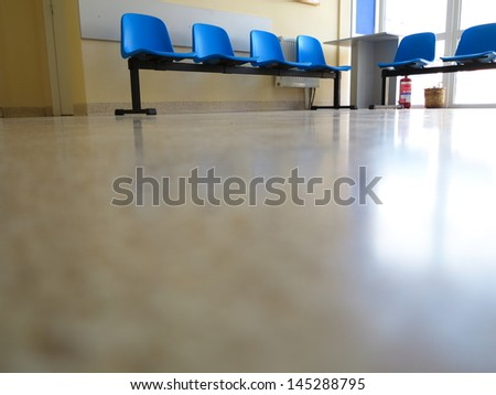 Interior of a waiting room blue stools, empty chairs. - stock photo
