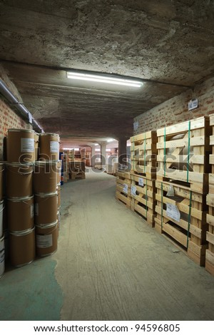 Interior of a warehouse in a printing factory, raw materials in stock.