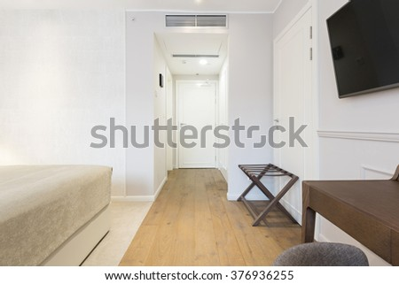 Interior of a white hotel corridor with closet - stock photo