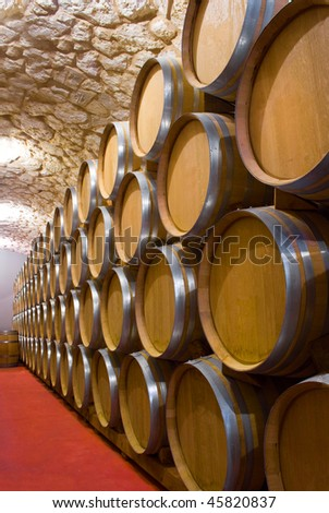 Interior of a wine cellar with a production of full barrel of wine closed - stock photo