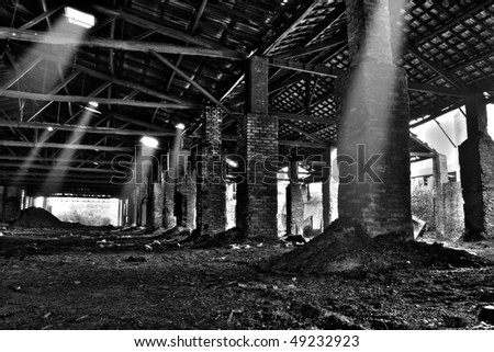 Interior of abandoned warehouse (black and white HDR photo)