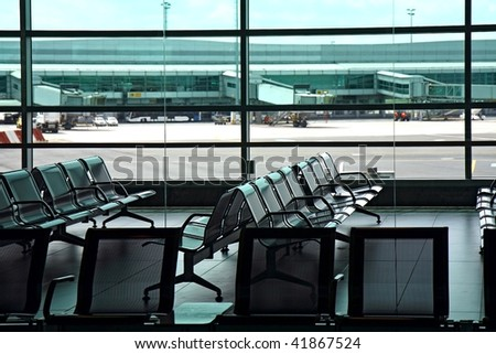 interior of airport hall with seats