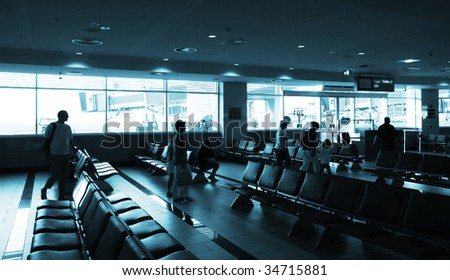 interior of airport with silhouettes - stock photo