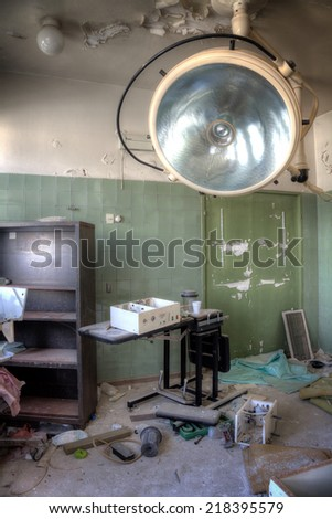 Interior of an abandoned building with rubble and debris. Deserted old hospital - stock photo
