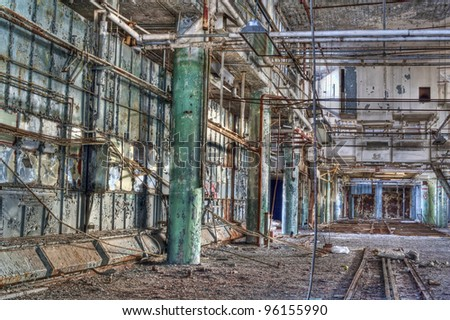 Interior of an abandoned factory. - stock photo