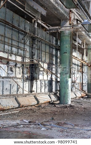Interior of an abandoned manufacturing plant in Detroit Michigan - stock photo