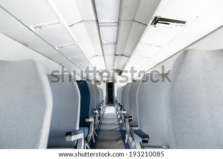 Interior of an airplane with many empty seats - stock photo