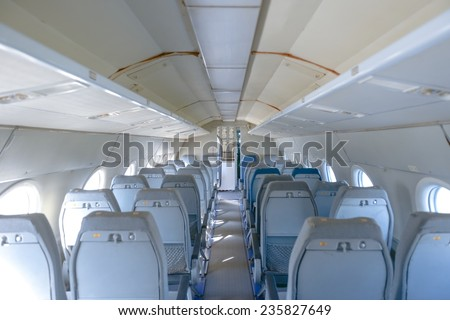 Interior of an airplane with many empty seats