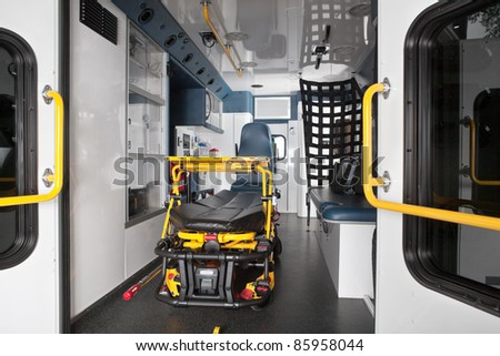 Interior of an empty ambulance with stretcher - stock photo