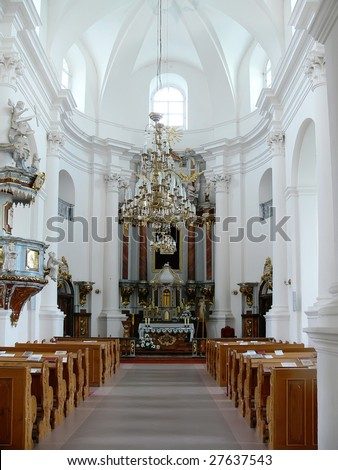 interior of an empty church with rows of benches - stock photo
