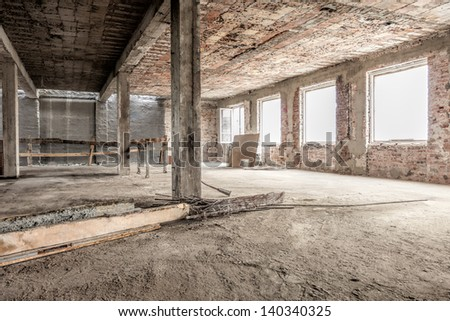 Interior of an empty old house structure - stock photo