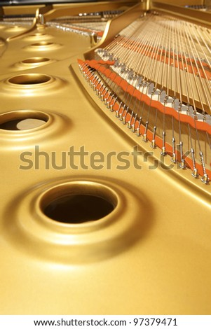 interior of an expensive and high professional piano - stock photo