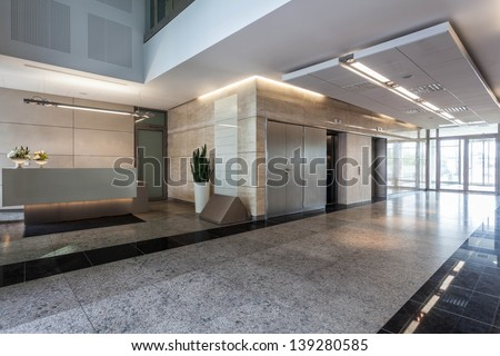 Interior of an office building with reception - stock photo