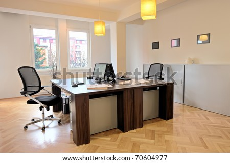Interior of an office with two chairs - stock photo
